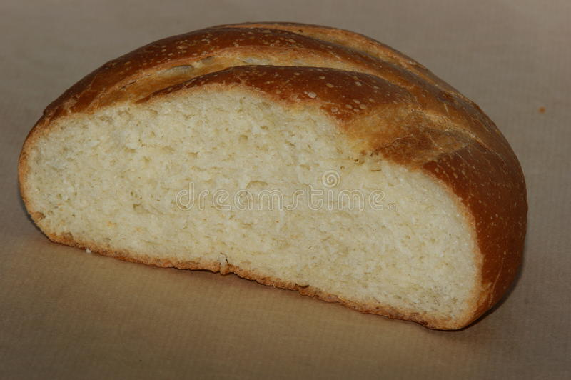 Round loaf of bread cutted stock photos