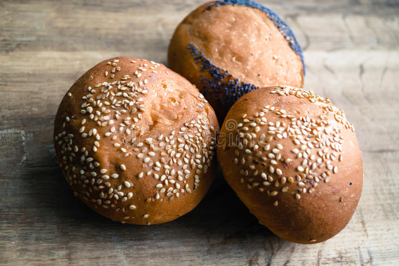 Round loaves are with a poppy and sesame royalty free stock images