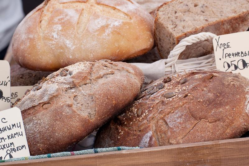 Round loaves of rye and wheat bread in the shop window stock photos