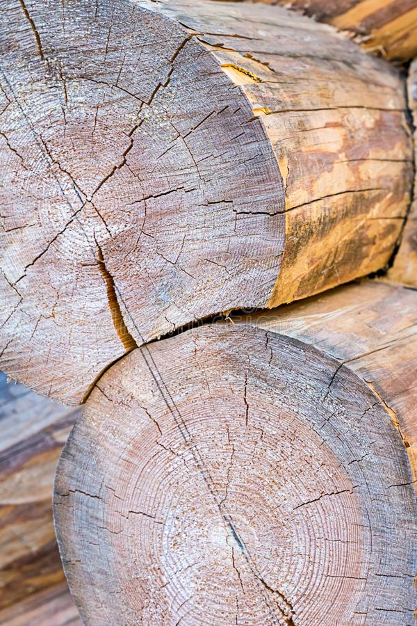Round log end weathered building materials sauna traditional heat preservation cracked surface stock photo