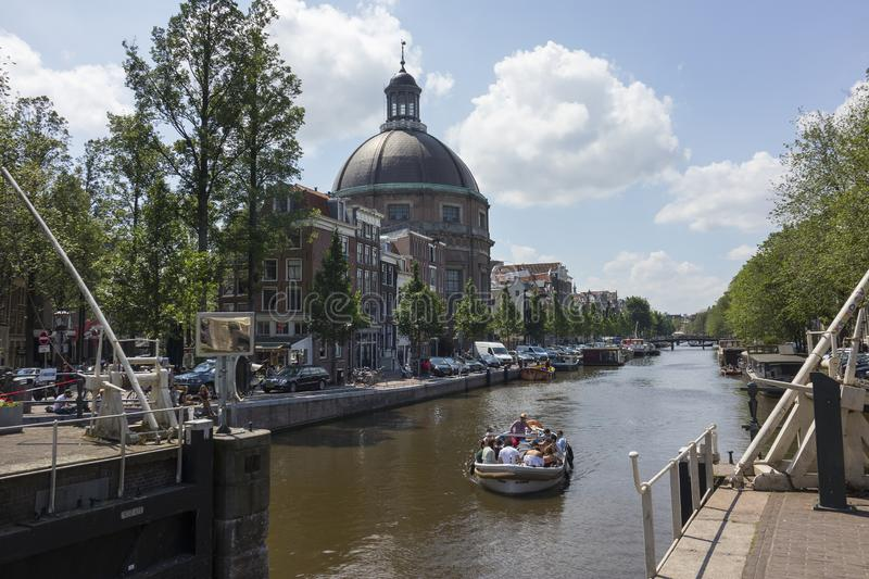 Round Lutheran Church seen from the Singel canal stock image