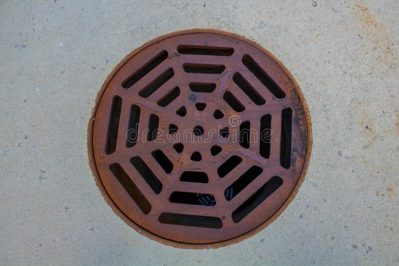 Round manhole cover in United States. Sewer cover plate stock image