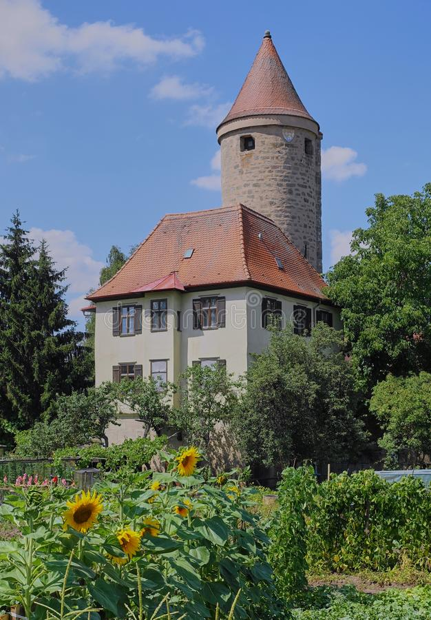 Round Medieval Tower with Sunflower Garden stock photography