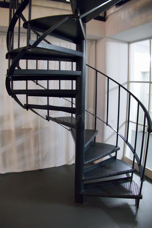 Download Round Metal Indoor Staircase In A Corner Stock Photo   Image:  102150214