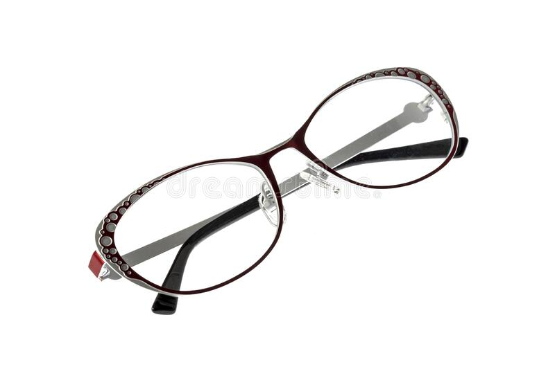 Round metallic glasses for a girl on a white background royalty free stock photo