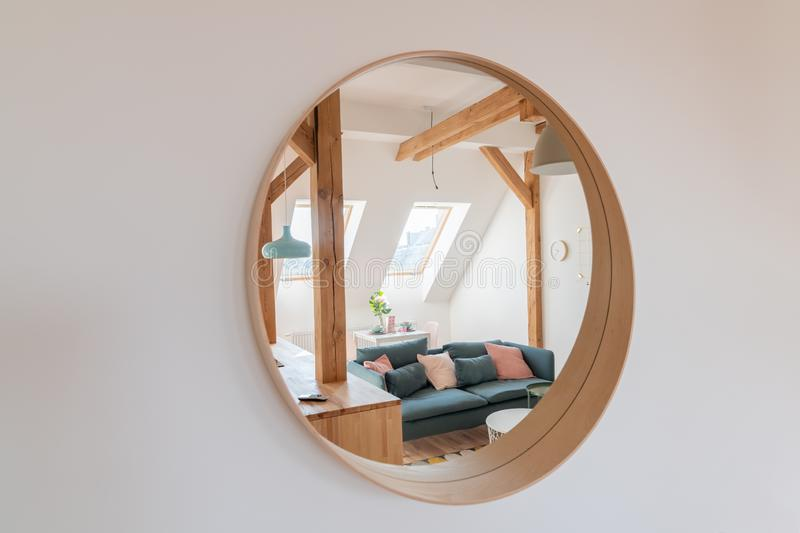 Round mirror on the living room wall. With reflection of living room stock photos