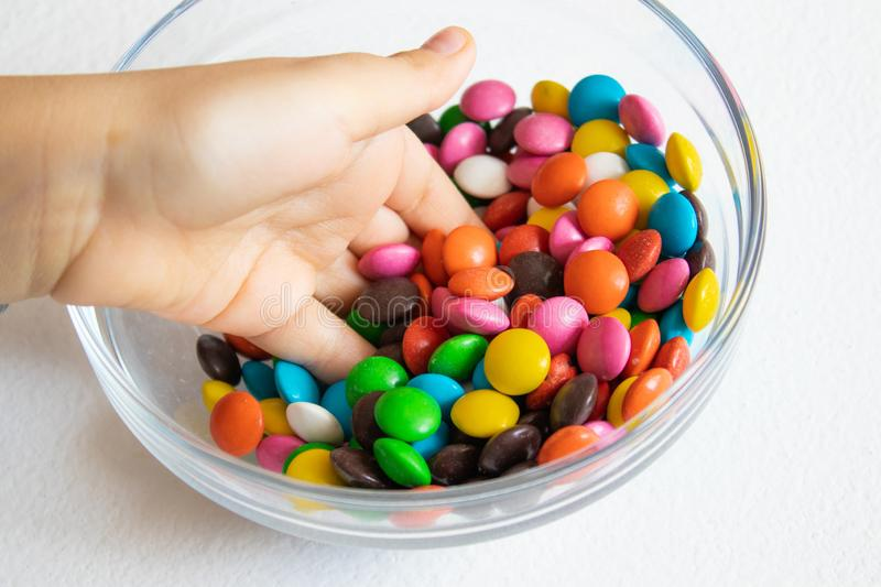 Round, multi-colored candies. Candy close-up, in a glass container royalty free stock image