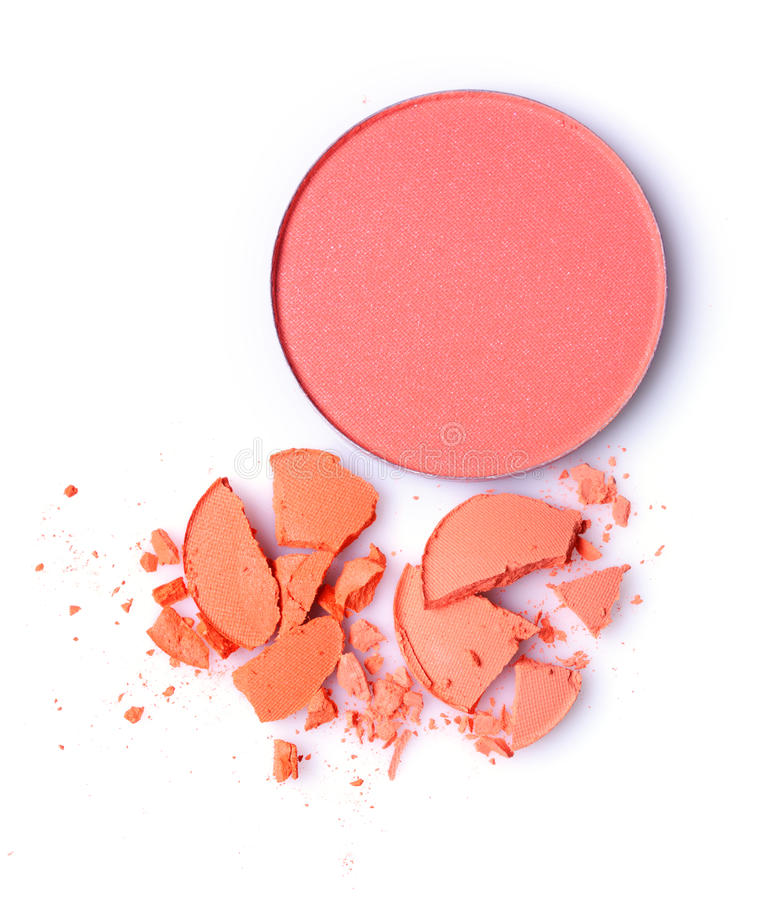 Round orange crashed eyeshadow and red blusher for makeup as sample of cosmetics product royalty free stock photo