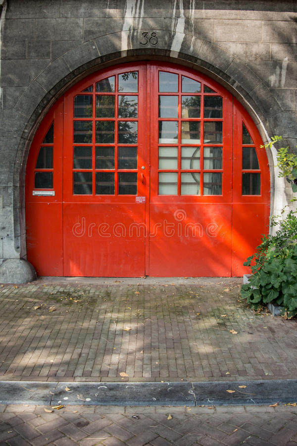Round Orange Door in Amsterdam stock photo