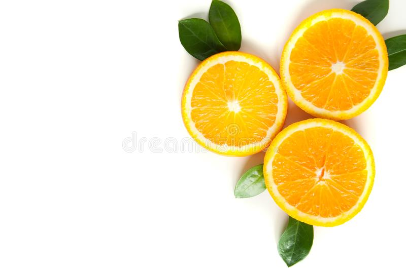 Round orange slices on a white background. Citrus tropical fruit background. Bright food. Dietary vitamin nutrition. stock image