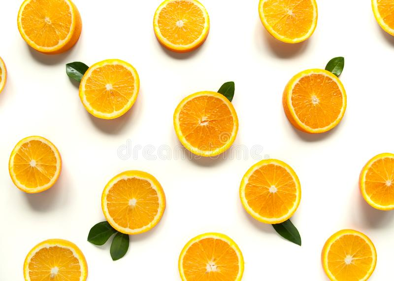 Round orange slices on a white background. Citrus tropical fruit background. Bright food. Dietary vitamin nutrition. stock photography