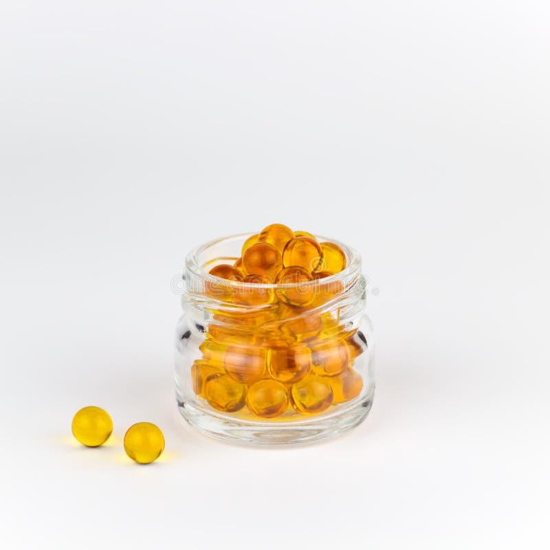 Round orange vitamins glass jar royalty free stock photos