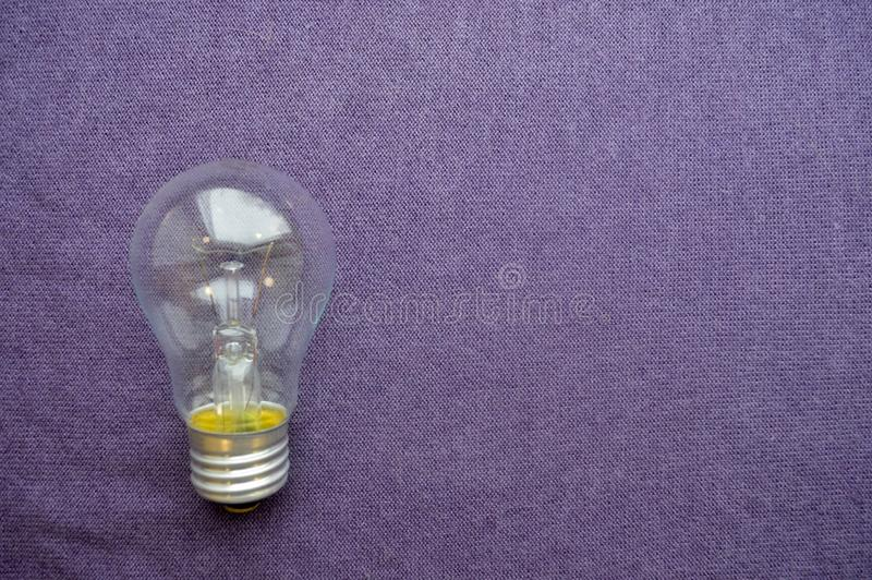 A round, ordinary, non-economical incandescent bulb with a transparent socle stock photography