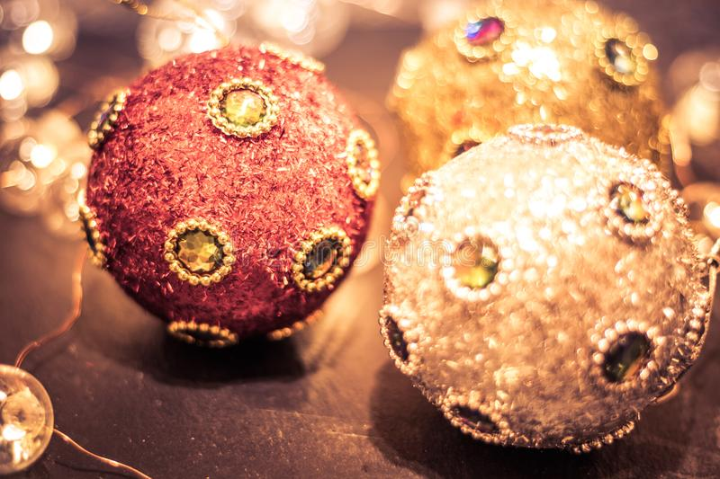 Round ornaments covered in rich jewels and glitter, baubles and soft lights for Christmas holiday, split tone royalty free stock images
