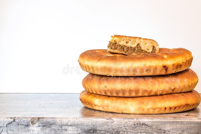 Round pie on dark wooden desk background. Top view. Template for restaurant menu, WEB site or presentation stock photos