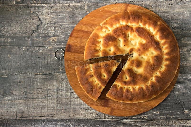 Round pie cake on dark wooden desk background. Top view flat lay pie. Template for restaurant menu pie or cake. WEB site or presentation stock images