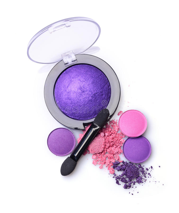 Round purple crashed eyeshadow for makeup as sample of cosmetics product with applicator. Round purple crashed eyeshadow for make up as sample of cosmetics royalty free stock photos