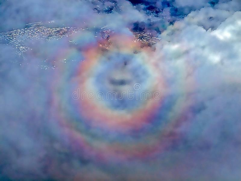 Round rainbow seen during a flight stock image