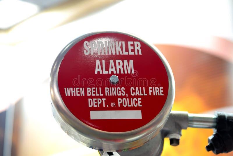 Round red fire alarm sensor. On blurred white background. Sprinkler alarm stock images