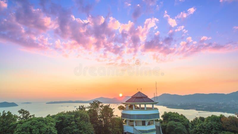 Round red sun above big Buddha royalty free stock photography