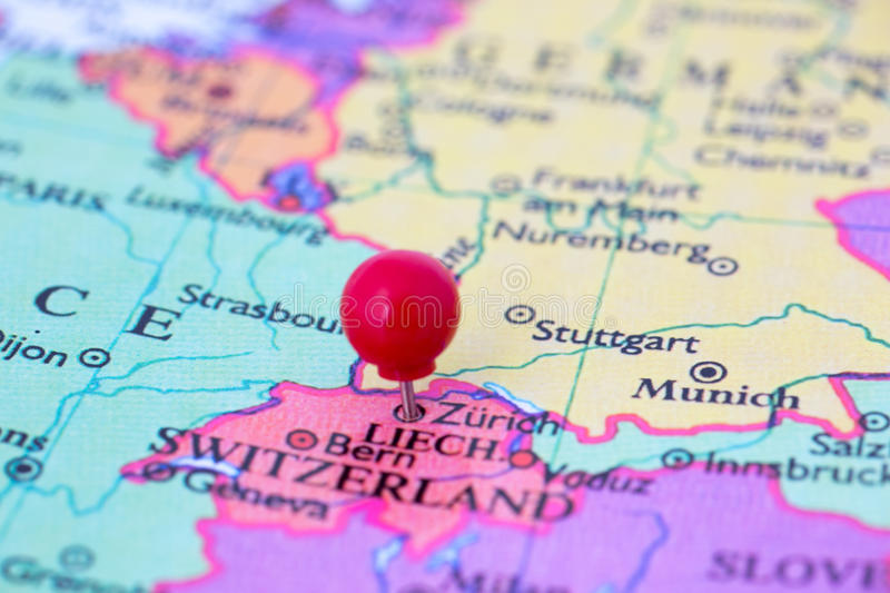 Red Pushpin on Map of Switzerland stock images