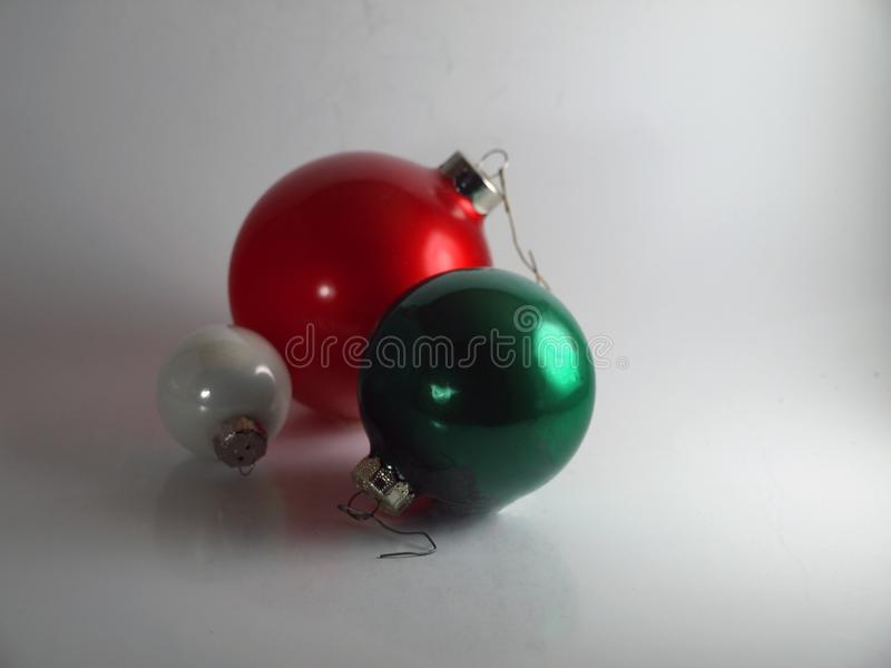 Round Red, White and Green Christmas Ornaments on a White Background royalty free stock photography