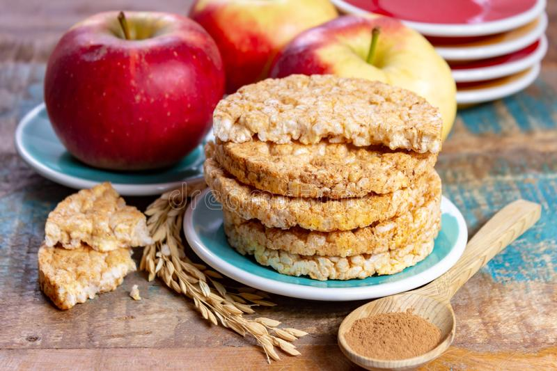 Round rice crackers made with apple and cinnamon, healthy snack for breakfast, lunch and school food stock photos