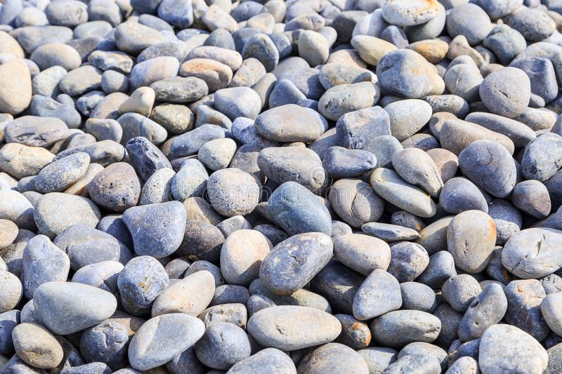 Round Rock Bin. Bin of round rocks used for construction, accent, spas, rock therapy, and landscaping stock image