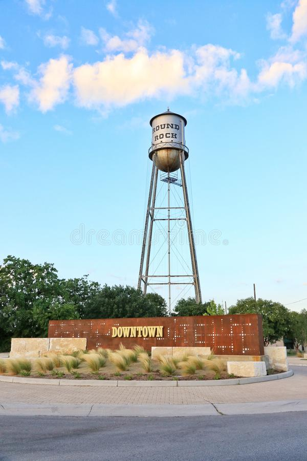 Round Rock, Texas Historic Old Water Tower. Blue sky and summer heat with metal silver water tower standing tall in downtown stock image
