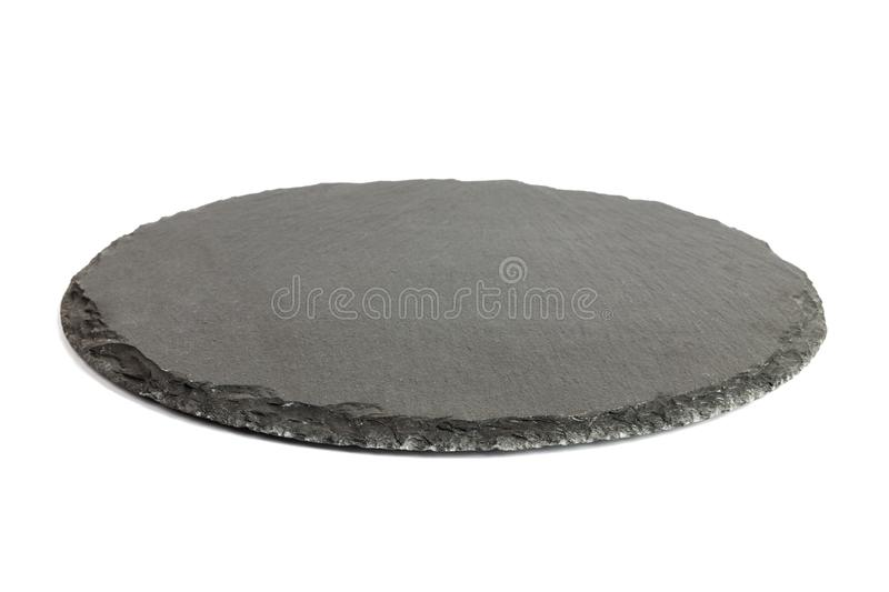 Round rustic black slate stone plate, isolated on white background.  stock photography