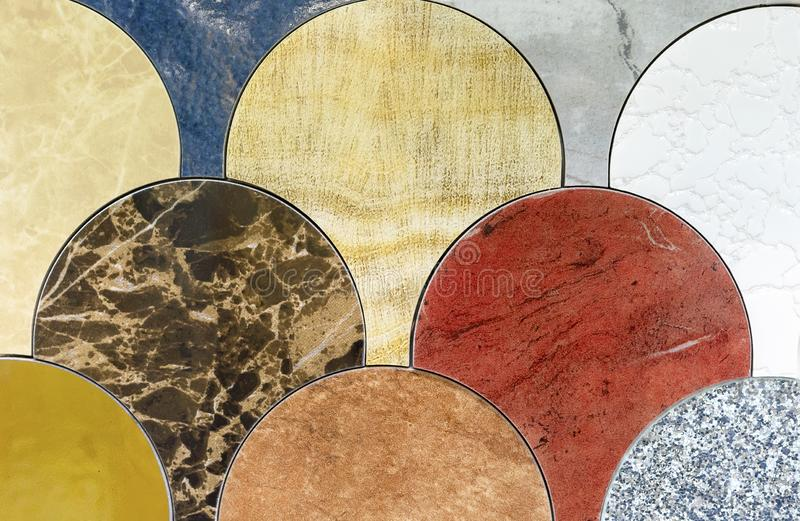 Round samples of natural marble of various shades royalty free stock photography