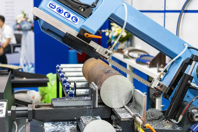 Round shaft steel is being cutting by automatic continuous and high speed horizontal band saw machine for industrial with the. Coolant fluid royalty free stock images