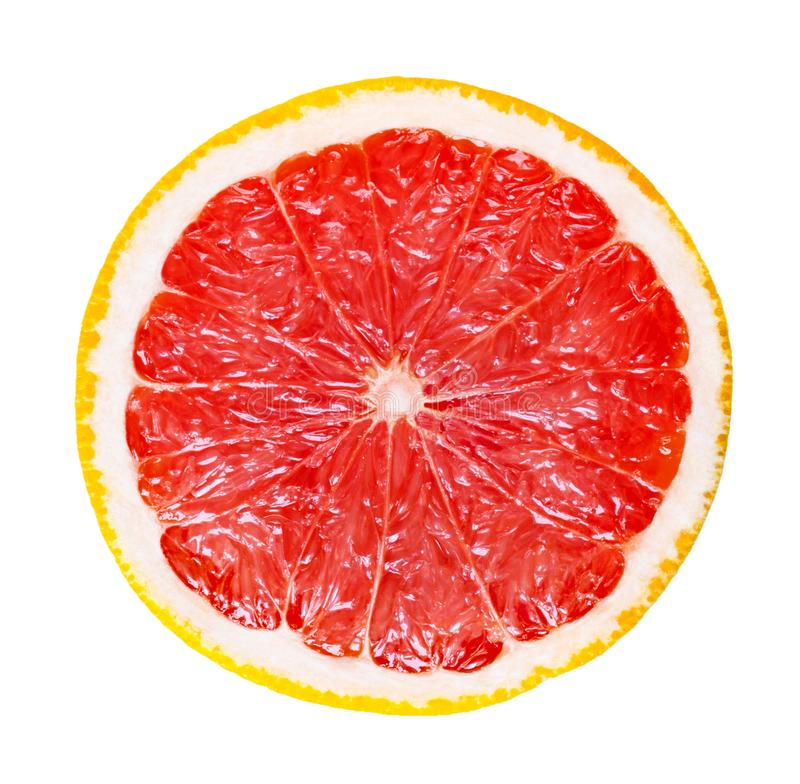 Slice of grapefruit isolated on a white background. Round slice of grapefruit isolated on a white background royalty free stock images