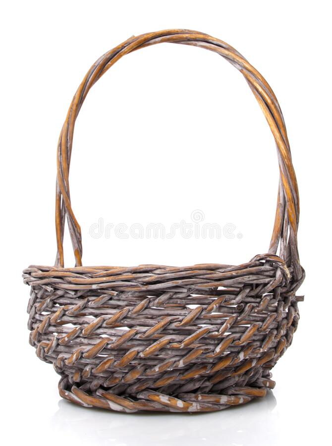 Round small wicker basket on a white background. The basket is made of vines stock photo
