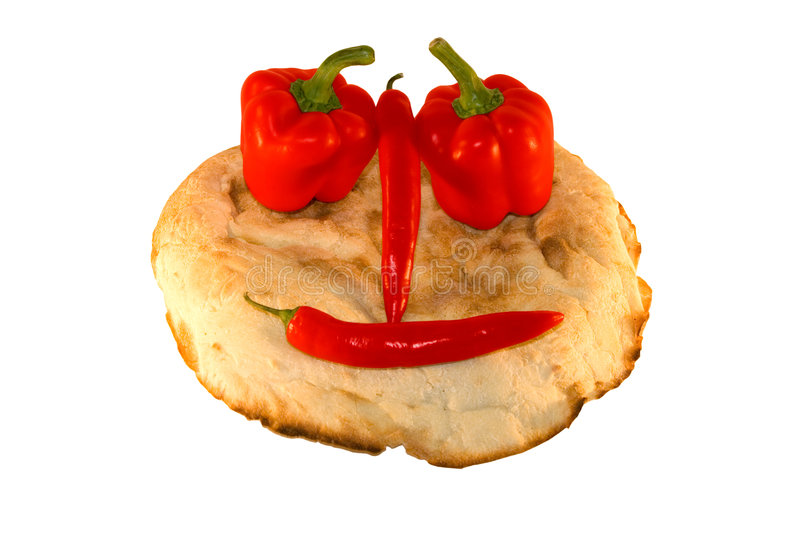 Round smiling bread with vegetables royalty free stock image