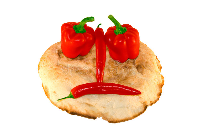Round smiling bread with vegetables stock image