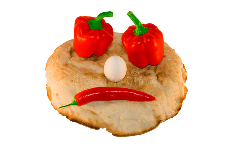 Round smiling bread with vegetables and eggs royalty free stock photo