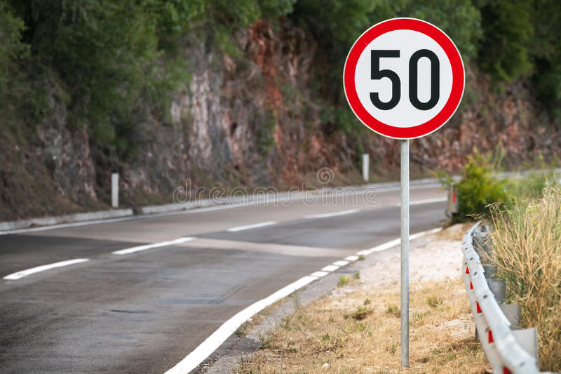 Round speed limit road sign stock image