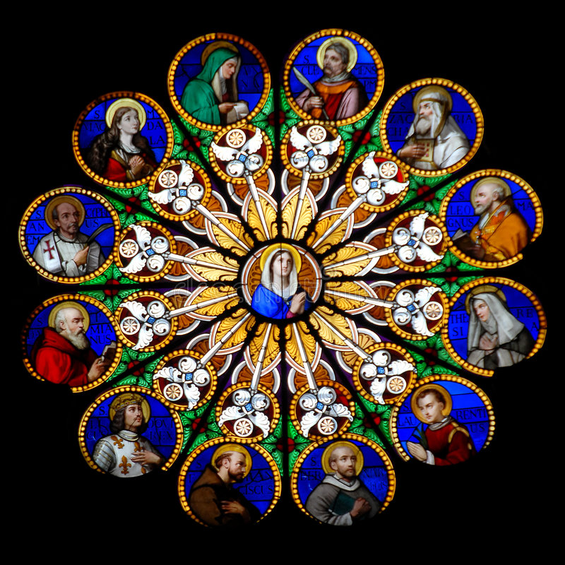 Round Stained Glass - Mary. Mother of Jesus, surrounded with many stained glass paintings of saints royalty free stock photos