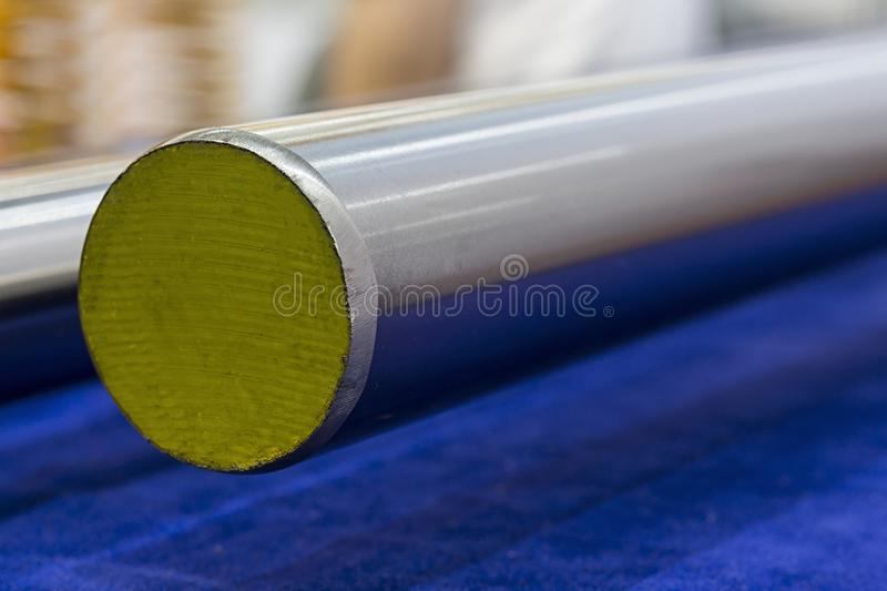 Round stainless steel bar. Grinding process stock images
