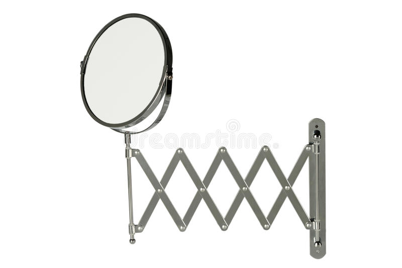 Round stainless steel magnifying mirror. Round magnifying mirror with a retractable wall-mounted stainless steel arm, isolated on white background royalty free stock images