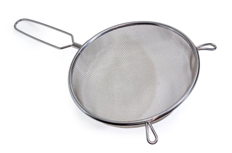 Round stainless steel sieve on a white background. Round stainless steel sieve with wire mesh on a white background stock photos