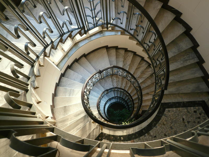 Round stairs. Decorated stairs in marble and steel viewed from above in an italian building of the beginning of the twentieth century stock photo