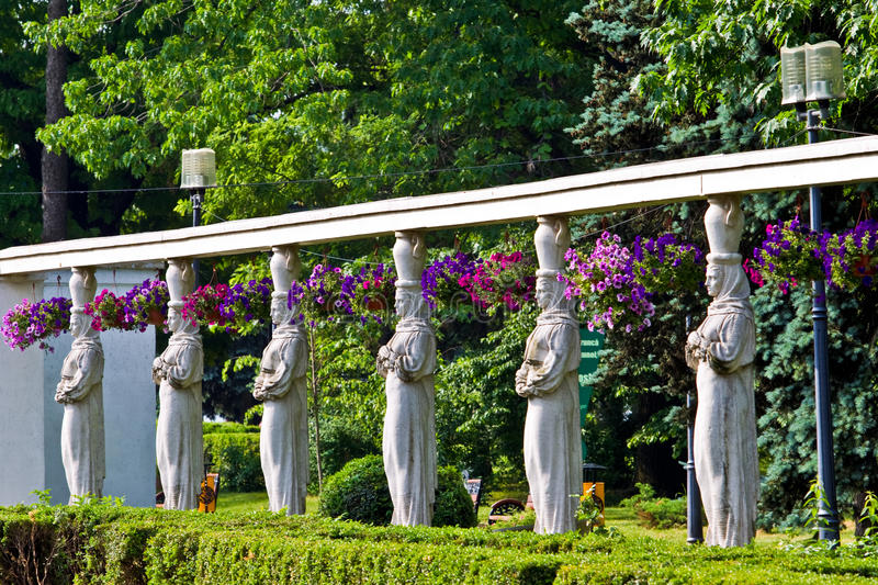Round of statues. In a park stock photo