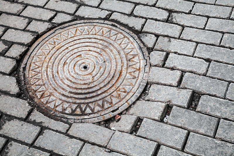 Download Round Steel Sewer Manhole On Old Stone Road Stock Photo - Image of infrastructure, metal: 28893080