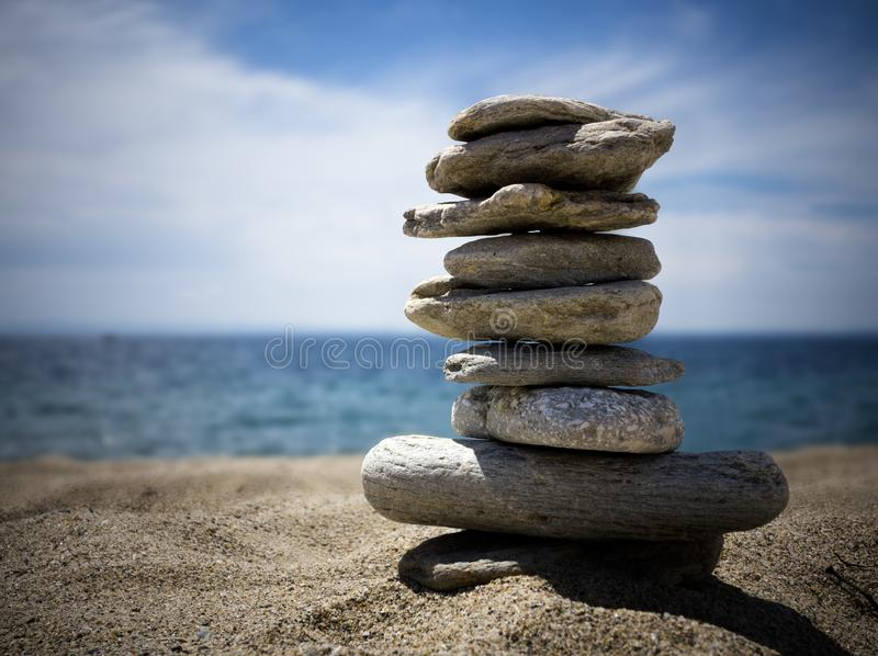 Stack stones on seacoast stock photo