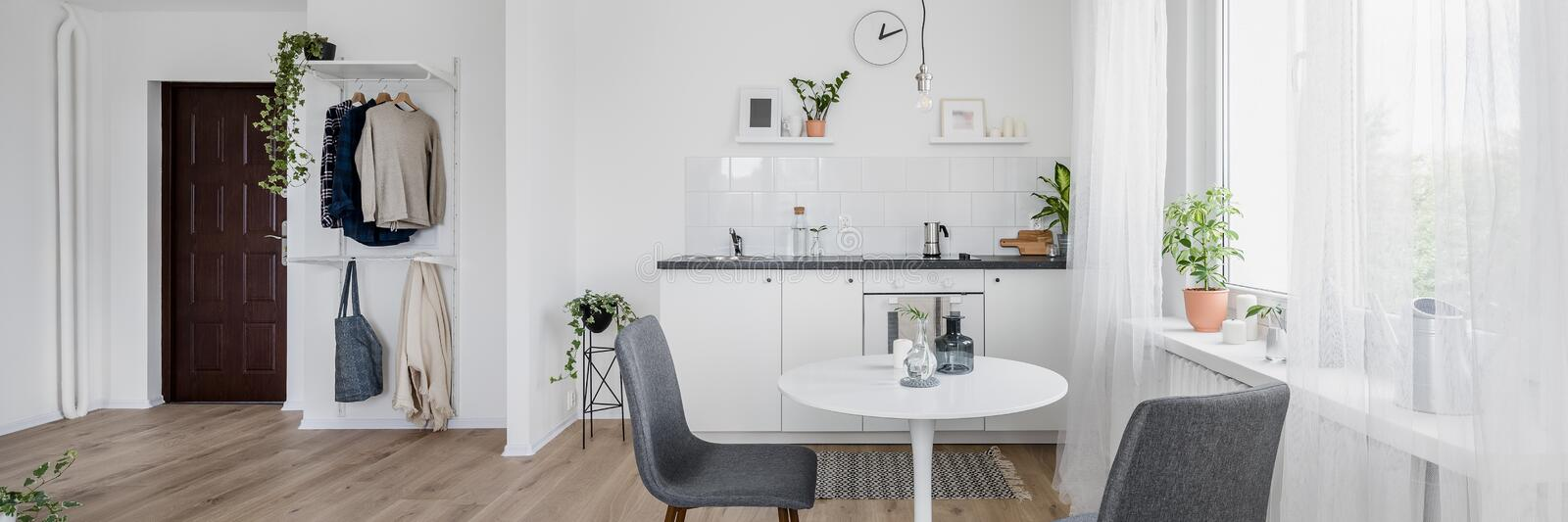 Round table and two chairs stock photos