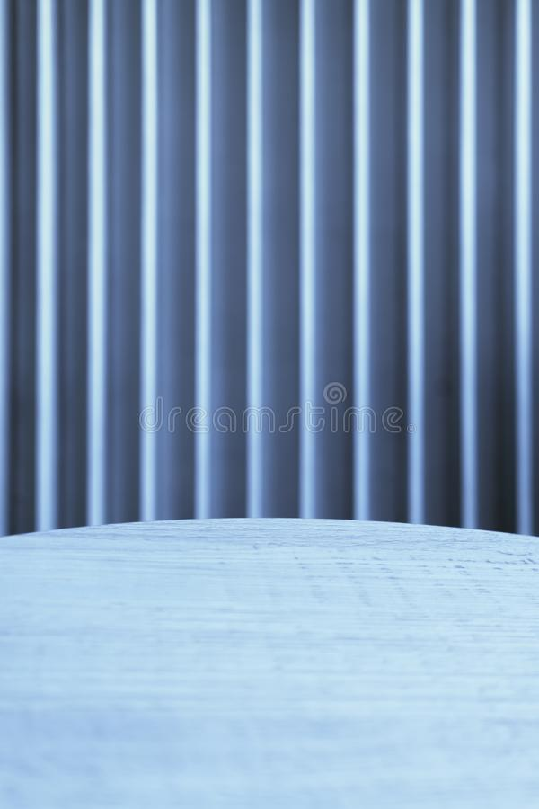 Round table by the window with blinds royalty free stock image