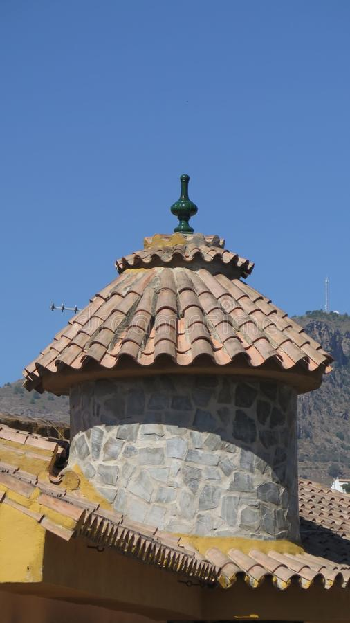 Round tiled turret on village restaurant in rural Andalusia stock photography