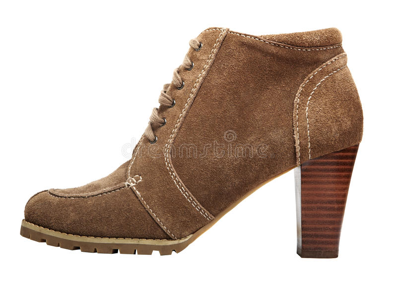 Round toe suede boot. Round toe suede ankle boot with high heel in beige brown colour isolated on white stock photo